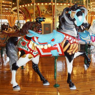 A person standing in front of a carousel