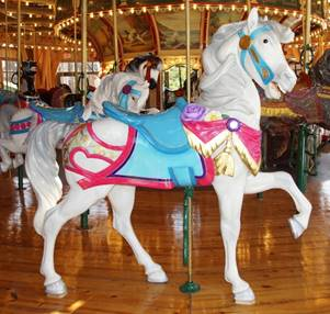 A horse standing on top of a carousel