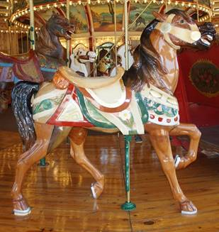 A picture containing carousel, indoor, ride, table