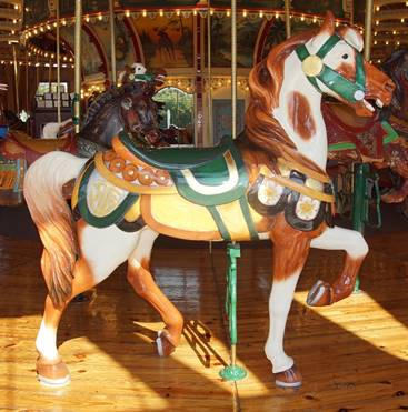 A person riding a horse in a carousel