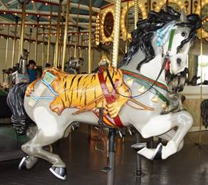 A picture containing carousel, ride, outdoor object, floor