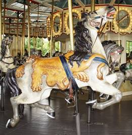 A picture containing carousel, ride, floor, indoor