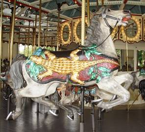A picture containing carousel, floor, ride, building