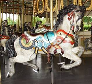 A picture containing carousel, ride, floor, outdoor object