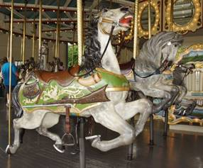 A picture containing carousel, ride, indoor, floor