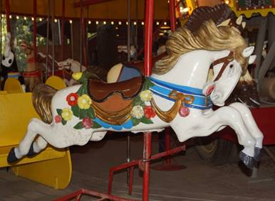 A picture containing carousel, outdoor object, ride, floor