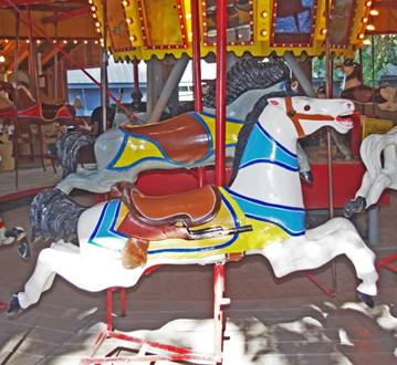 A picture containing carousel, ride, indoor, table