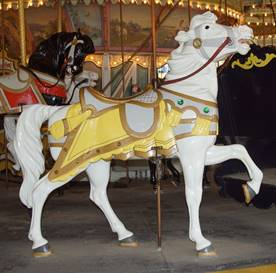 A close up of a carousel horse