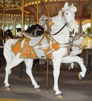 A picture containing carousel, outdoor object, ride, building