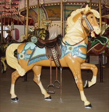 A picture containing floor, carousel, ride, object  Description automatically generated