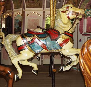 A chair sitting in front of a carousel  Description automatically generated