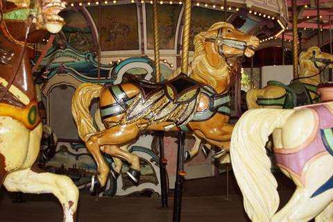 A close up of a carousel  Description automatically generated
