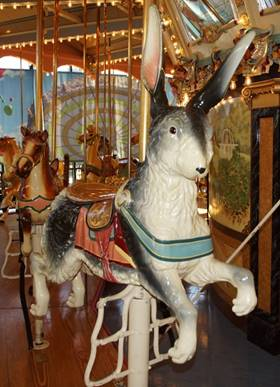 A picture containing carousel, outdoor object, ride, indoor  Description automatically generated