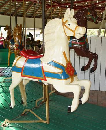 A chair sitting in front of a carousel