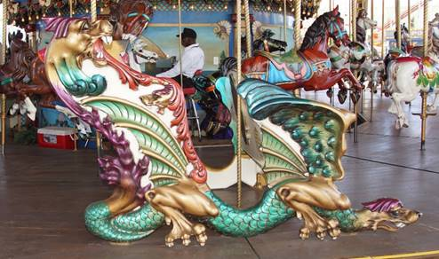 A picture containing carousel, floor, indoor, ride