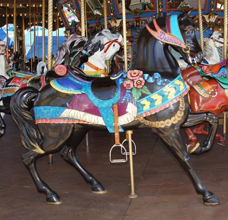 A picture containing carousel, floor, ride, indoor