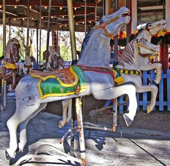 A picture containing carousel, ride, outdoor object, ground