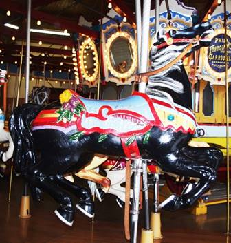 A picture containing carousel, ride, floor, indoor  Description automatically generated
