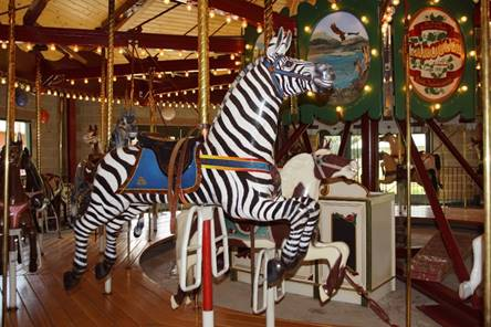 A picture containing carousel, ride, outdoor object, floor  Description automatically generated