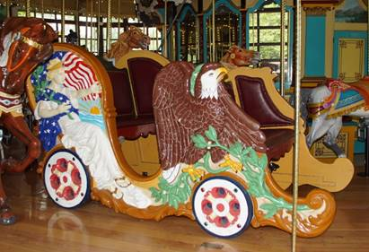 A picture containing indoor, carousel, ride, floor  Description automatically generated