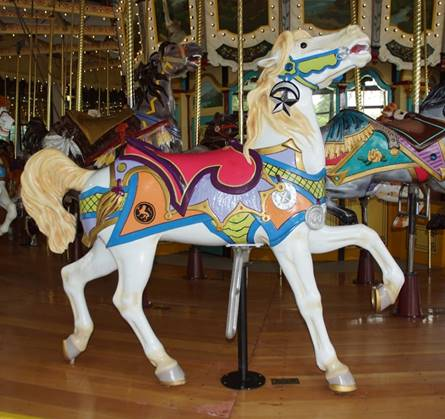A picture containing carousel, floor, ride, outdoor object  Description automatically generated