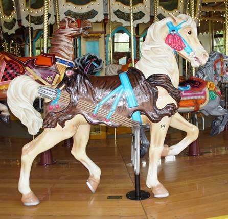 A picture containing floor, carousel, indoor, ride  Description automatically generated