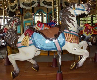 A picture containing carousel, ride, outdoor object, indoor  Description automatically generated