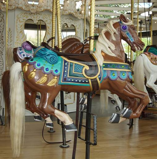 A picture containing carousel, floor, outdoor object, ride  Description automatically generated