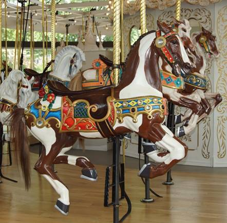 A picture containing carousel, floor, indoor, ride  Description automatically generated